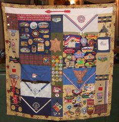 Boy Scout quilt. Awesome! This is the best one yet! It has all the uniforms and all the merit badges from day one on here. It just rocks!