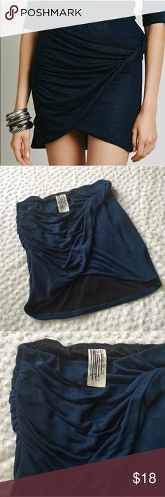 Free People Simone twist skirt Medium navy Free People Simone Twist skirt in size medium. Navy blue color. Stock pictures in ruby color to help to fit! (This can also be worn as a tube top!) Free People Skirts Mini