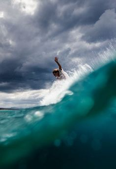 Surfer with storm clouds in the distance★★ //Manbo