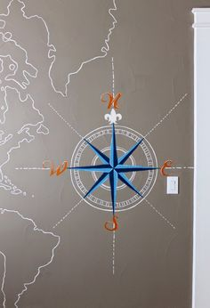 Nautical Boys Room. map wall mural and compass hand painted on wall. oranges, and blues. Theraggedwren.blogspot.com