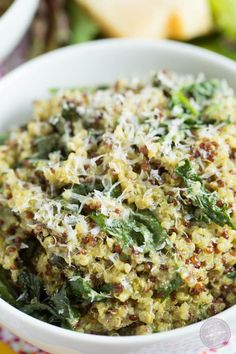 You'll have dinner on the table in no time with this 15-minute spinach pesto quinoa bowl! Recipe on tablefortwoblog.com