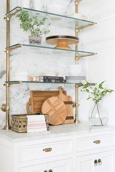 Use wallpaper to upgrade shelving. Assemble-yourself bookcases are an economical choice, but they tend to be boring and look a bit cheap. To make them more stylish, try adding a bold wallpaper on the back of each shelf. Glass Shelves Kitchen, Kitchen Storage, Wine Storage, Kitchen Organization, Organization Ideas, French Bistro, New Energy, Wood Pieces, New Kitchen
