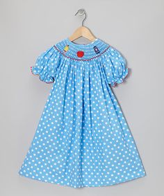 This dress brings contemporary charm to any cutie's closet by combining timeless smocking with vibrant colors. Handmade from crisp cotton, it's sure to last through loads of play and pulls on easily thanks to the buttons in back.