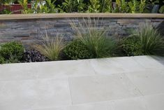 Portland stone is another one of our revered indigenous stones. A pale, chalky white colour Portland stone is softer and more delicate than York stone and is often used for intricate carving and bespoke stonework Garden Floor, Garden Paving, Garden Stones, White Pebble Garden, Limestone Patio, Stone Driveway, Driveway Pavers, York Stone, Portland Stone