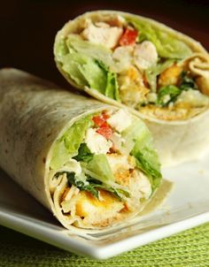 Chicken Caesar Wraps with Romaine Lettuce, Caesar Dressing, Parmesan Cheese, Chicken Breast, Croutons, Diced Tomatoes, Tortilla Wraps.