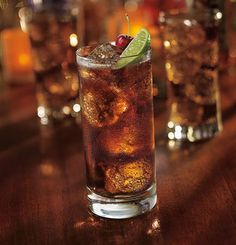 The Henry: Spiced Rum, Amaretto, Cola, Lime Wedge, Cherry.