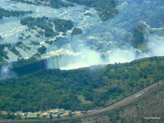 One of our favourite clients, Lori Ann Graham, gives a first hand account of her trip to one of the Seven Wonders of the Natural World: the Victoria Falls. Chutes Victoria, Victoria Falls, Seven Wonders, Holiday Destinations, Natural World, Niagara Falls, Waterfall, The Incredibles, River
