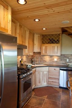 Pics of common commercial metal buildings. Knotty Pine Kitchen, Kitchen, Home, Pine Kitchen, Morton Building Homes, Cabin Kitchens, Kitchen Remodel, Morton Homes, Alder Kitchen Cabinets
