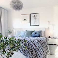 Scandi bedroom decor with art prints above the bed.