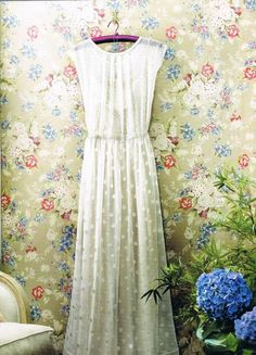 . This would make a beautiful wedding dress that could be shortened for everyday wear.