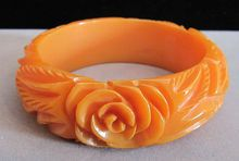 Vivid Vintage Orange Floral Carved Bakelite Bangle