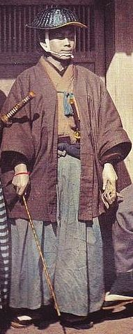 Samurai holding a muchi (whip) and wearing a jingasa.