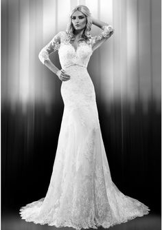 Wedding dress crafted in lace and taffeta Heart-shaped cleavage with built in corset Midi length lace and tulle sleeves Waist detail Manual embroidery with lace, beads and crystals Back closes with zipper Long train
