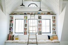 Consider a novel approach to the reading nook by framing your windows with books. The combination of color and natural light adds major impact to a whitewashed space. We're also suckers for...