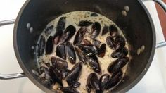 Mussels at home! Cooked in white wine cream sauce. Perfect with crusty bread.