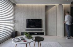 Modern industrial apartment located in Taiwan, designed in 2018 by AworkDesign. Studio Apartment, Apartment Design, High Rise Apartments, Sala Grande, Industrial Apartment, Black Cabinets, White Ceiling, Black Walls, Living Area