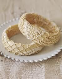 Cheap plastic bracelet's covered with vintage doilies.