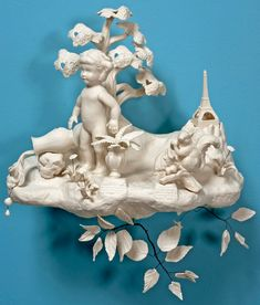 Beth Katleman's sculptures and installations combine rococo decoration with icons from popular culture. Beth uses 1950's squeaky toys, corporate mascots, miniature buildings, cartoon characters and dolls which she finds in secondhand thrift stores and flea markets. These trinkets are cast in clay and reinvented as bizarre porcelain objects.