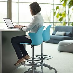 Providing an elevated area for working and meeting with coworkers for a quick collaboration is great, like this counter and  Node Mid-Back Stool set up.