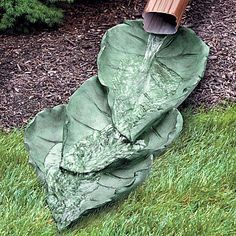 I think this might be a DIY project with concrete and some leaves for making the imprints!  Great alternative to ugly plastic downspout extensions. :-)