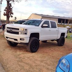 White lifted Chevrolet Silverado truck with Chevy Bow-Tie