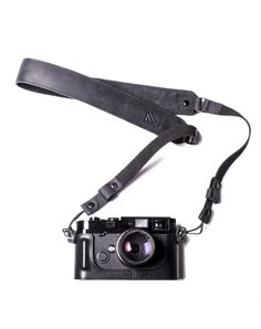 You've made the investment in the best hardware; now it's time to step up your softwear. Trust us: you will never miss the chintzy nylon and plastic sling that came with your SLR. Available in full grain black or tanned leather, our straps feature a padded suede lining, black stainless hardware, and convenient quick-releases.