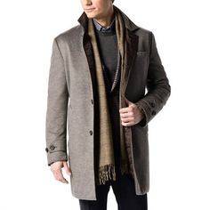 Expertly tailored in luxurious Italian wool and cashmere fabric from Barberis, this coat has a lightweight quilted interior that adds warmth and a casual touch.