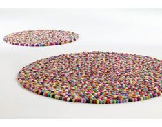 Pinocchio by Hay is named after a Danish candy and gives everyone, if young or old, a smile on the lips. The carpet are handmade in Nepal. The single felt balls are rolled by hand and then put on the cord like perls. In all its different sizes Pinocchio Pinocchio, Design Online Shop, Design Shop, Circular Rugs, Felt Ball Rug, Cadeau Design, Hay Design, Deco Kids, Scandinavia Design
