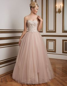 Justin Alexander wedding dresses style 8847 Sorbet/Silver Size 8. Sweetheart beaded bodice, natural waistline and tulle ball gown skirt with tiers of beaded trim. A classic, elegant gown rich in color.