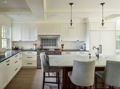 Marble counter with oil rubbed bronze fixtures and pulls