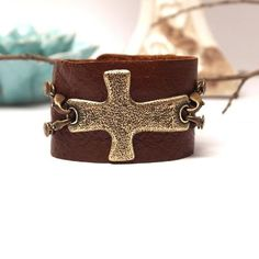 At LuLu Luxuries (FB)   Lenny and Eva Wide Chestnut Cuff with Bronze Cross Pendant.  Price: $41.80  The Cross is interchangable, you can also add dangles to sides...I WANT THIS!!! Love this cross/in silver.