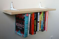 The Inverted Bookshelf turns a bit of your living room upside down as it hangs all of the books from the bottom instead of supporting them from below. It's a satisfying optical trick and doesn't damage any of the books.