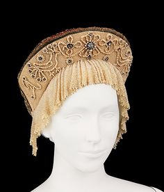 Headdress Date: 1790–1810 Culture: Russian Medium: silk, glass, cotton, metal, pearls Dimensions: 6 x 9 1/2 in. (15.2 x 24.1 cm) Credit Line: Brooklyn Museum Costume Collection at The Metropolitan Museum of Art, Gift of the Brooklyn Museum, 2009; Gift of Mrs. Edward S. Harkness in memory of her mother, Elizabeth Greenman Stillman, 1931