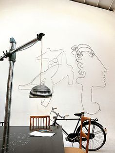 Abstracted figural wire wall sculpture in this artistic loft space- beyond fabulous!