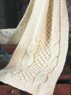 Knit a cable scarf with this free knitting pattern designed by Fran Marlin. Cables can become addictive! So try this scarf, with chunky weight yarn and size 10mm needles.