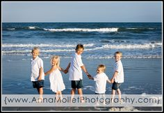 Think this photographer is amazing to get FIVE kids to pose so beautifully!