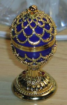 Fabrege Jeweled Egg. Royal blue and lots of gold...Fabrege