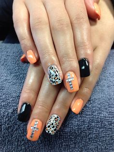 Charlene's nails. Cross and cheetah print gel nail art.