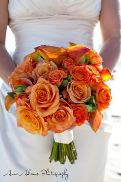 Orange mix flower bouquet.  Flowers of Charlotte loves this!  Find us at www.charlotteweddingflorist.com