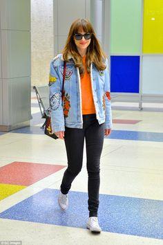 Fifty Shades of Grey star Dakota Johnson models denim Gucci jacket at JFK airport | Daily Mail Online