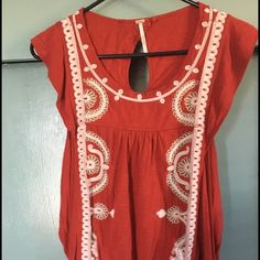 Red free people with white detail shirt Size small but can fit medium. Elastic bottom, loose fitting and really cute. New, washed but not worn. Free People Tops Blouses
