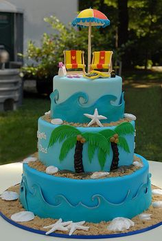 Beach Anniversary Cake-- add cruise ship on bottom layer {surf boards on the top instead}