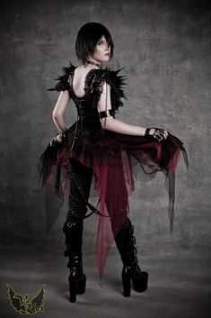 Cute skirt and the frilly spikey look on the shoulders is neat. I like it.