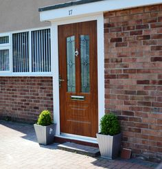 An industry-leading manufacturer of tailor-made composite doors, stable doors and french doors with unmatched strength and security. Oak Front Door, Back Doors, Composite Door, Golden Oak, Light Oak, Glass Design, Illinois, Home Improvement, Garage Doors
