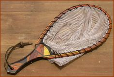 "Custom Wood Fly Fishing Landing Net # 9 In Ebony, Bird's Eye Maple, Osage Orange, Bubinga, Poplar, Pernam Buco,  Lacewood, Black Walnut, Eastern Walnut, Manzanita Burl, Mahogany,  Frame in constructed using 20 separate discontinuous pieces with ebony separators. Hand dyed 1/4"" nylon mesh catch and release netting Black Leather Lacing and Lanyard 10 coats marine varnish 20""LOA  x 10""W x13""L x 14""D"