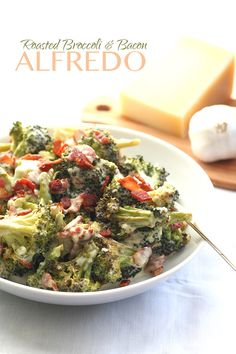 Low Carb Roasted Broccoli Alfredo with Bacon - This just might be the best low carb side dish recipe ever! Creamy Alfredo sauce and crisp crumbled bacon take roasted broccoli to a whole new level.