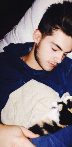 Cody Christian being cute as heck with his cat