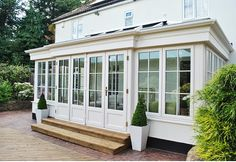 Orangery system with feature bi folding doors French Doors Patio, Patio Doors, Concertina Doors, Orangery Extension, Glass Porch, Porch Enclosures, Four Seasons Room, Sunroom Addition, House Extensions