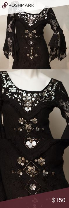 Free People Black Cocktail Dress Stevie Nicks is eating her heart out! Elegant pearlescent sequin and bead detailing. Draped lace sleeves with flare, fringed detailing on hem. Deep scoop neck, wide shoulder set.  Back zip. Mid thigh length. Excellent condition. Free People Dresses Long Sleeve