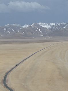 Tibet '06 - lonely highway to Nam Tso by mckaysavage ~ Tibet is big and vast and empty and this picture really brings that home. This is the highway along the plains butting Nam-Tso (Tso=Lake) en route to Tashi Dor Monastery.